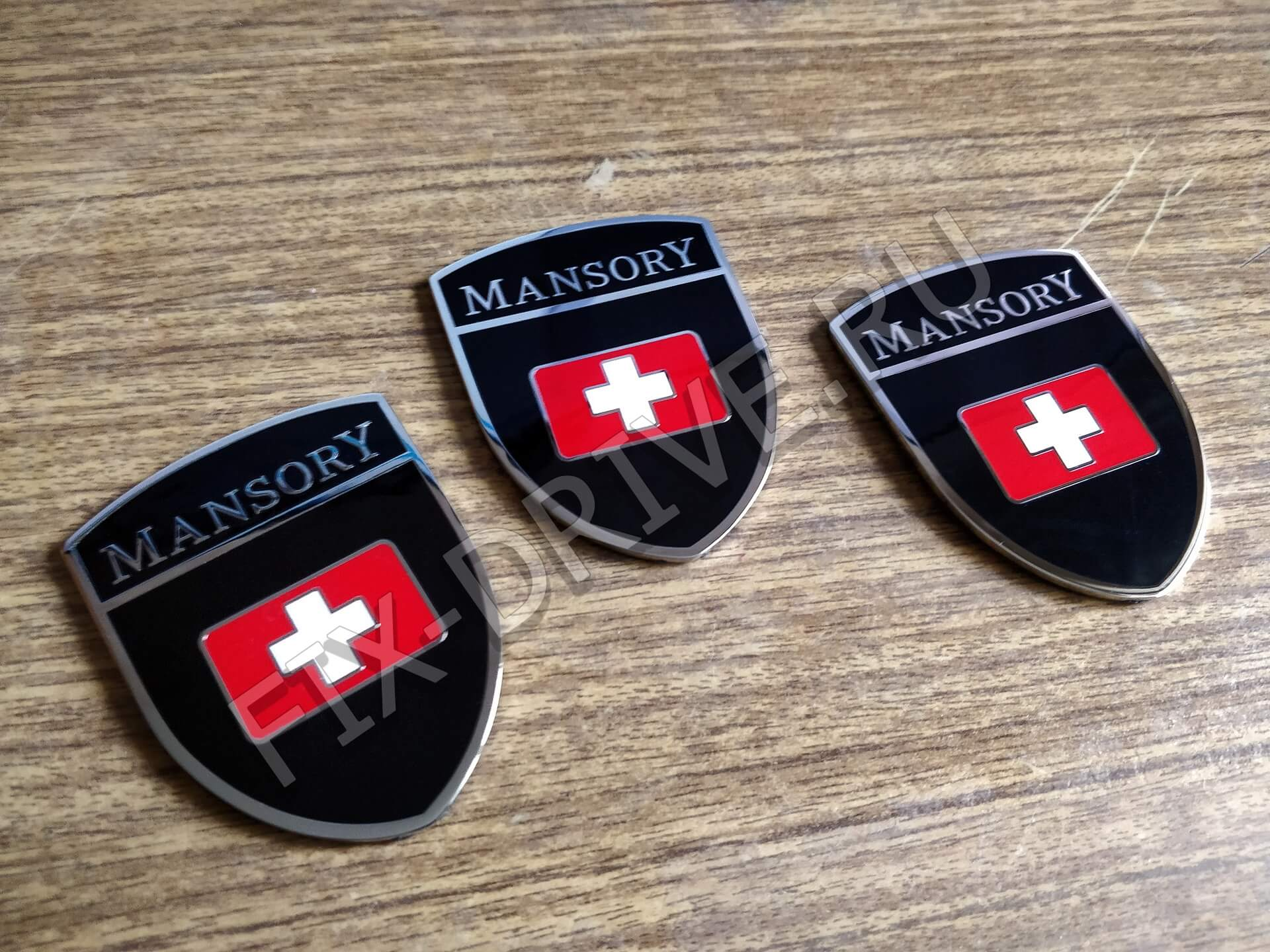 Эмблемы Mansory Porsche Cayenne 958